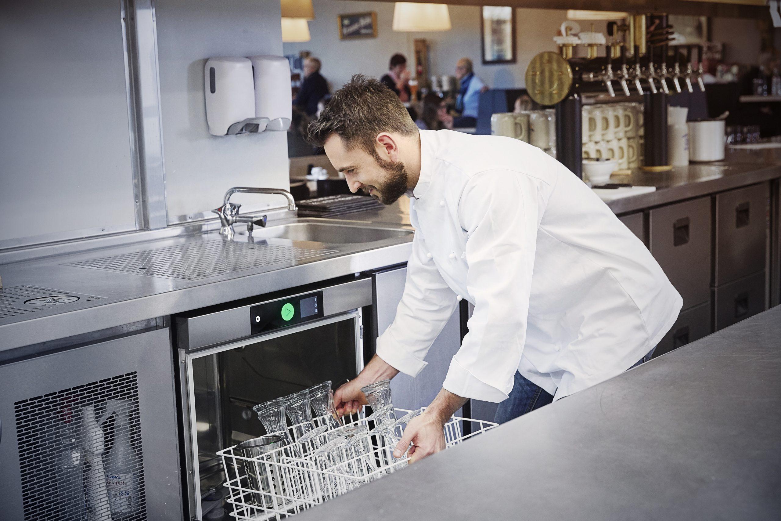 Chef filling dishwasher